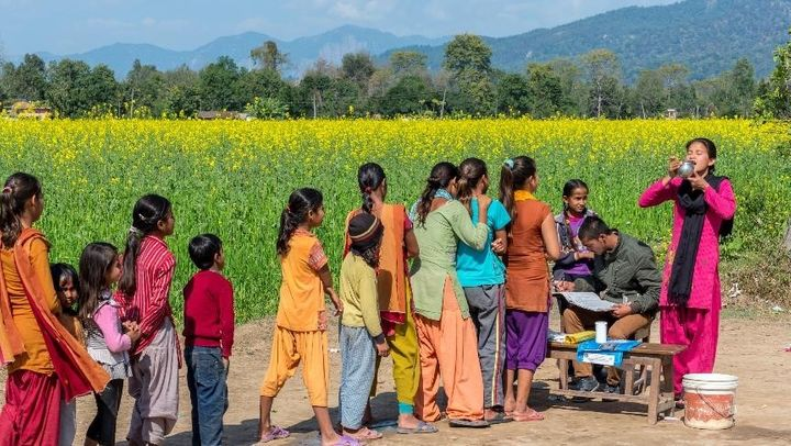 Women and girls line up during a mass treatment campaign for NTDs in Nepal.
