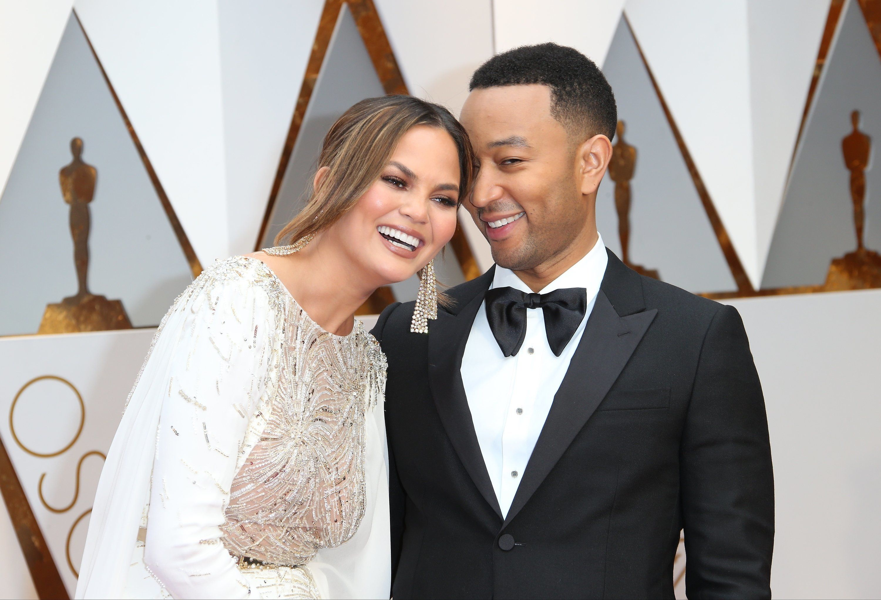 HOLLYWOOD, CA - FEBRUARY 26: Model Chrissy Teigen (L) and musician John Legend arrive at the 89th Annual Academy Awards at Hollywood & Highland Center on February 26, 2017 in Hollywood, California. (Photo by Dan MacMedan/Getty Images)