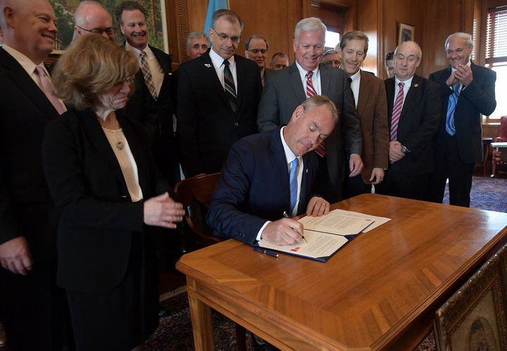 Interior Secretary Ryan Zinke signs an order in early March to overturn a federal ban on hunting with lead ammunition.