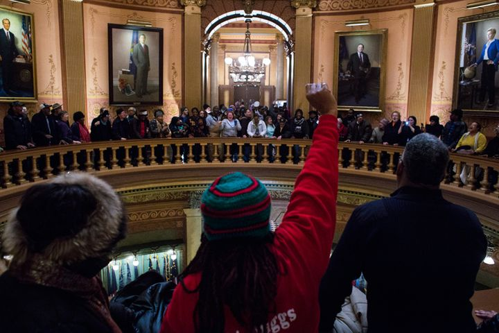 Last year, dozens gathered around the balcony of the Michigan State Capitol and called for the resignation of Governor Snyder
