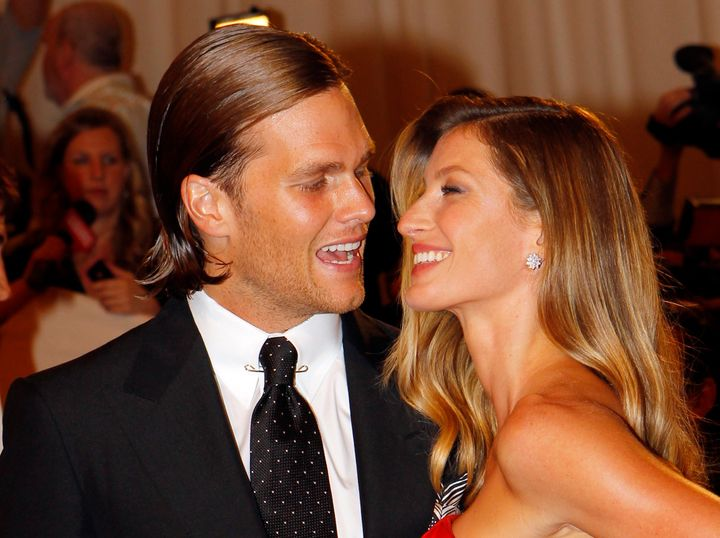 """Giselle Bundchen and New England Patriots NFL quarterback Tom Brady arrive at the Metropolitan Museum of Art Costume Institute Benefit celebrating the opening of the exhibition """"Alexander McQueen: Savage Beauty"""" in New York May 2, 2011."""