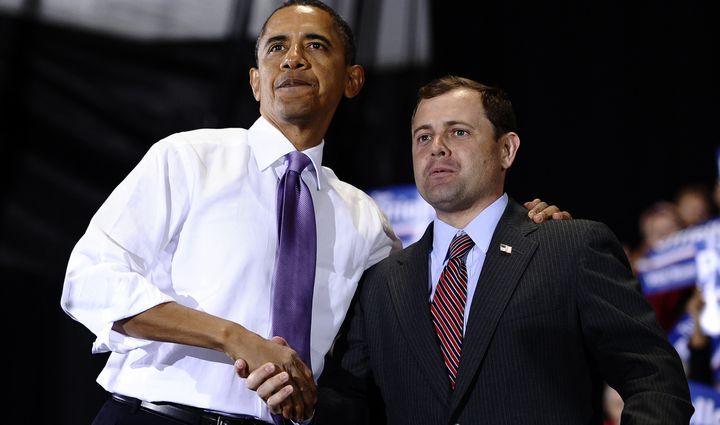 President Barack Obama shakes hands with Rep. Tom Perriello (D-Va.) at a rally in Charlottesville on Oct. 29, 2010, days befo