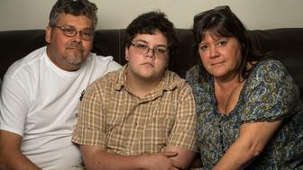 GLOUCESTER, VA --  AUGUST 21: Gavin Grimm, 17, center, is photographed at his home with his parents, David Grimm, left, and mom Deirdre Grimm, in Gloucester, Virginia, on Sunday, August 21, 2016. The transgender teen sued the Gloucester County School Board after it barred him from the boys' bathroom. (Photo by Nikki Kahn/The Washington Post via Getty Images)