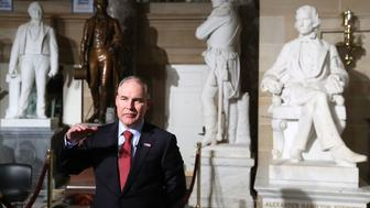 WASHINGTON, DC - FEBRUARY 28:  EPA Administrator Scott Pruitt does a television interview in Statuary Hall at the U.S. Capitol before President Donald Trump delivers a speech to a joint session of Congress on February 28, 2017 in Washington, DC.  Trump's first address to Congress is expected to focus on national security, tax and regulatory reform, the economy, and healthcare.  (Photo by Mark Wilson/Getty Images)