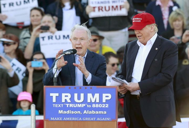 U.S. Senator Jeff Sessions speaks next to U.S. Republican presidential candidate Donald Trump at a rally at Madison City Scho