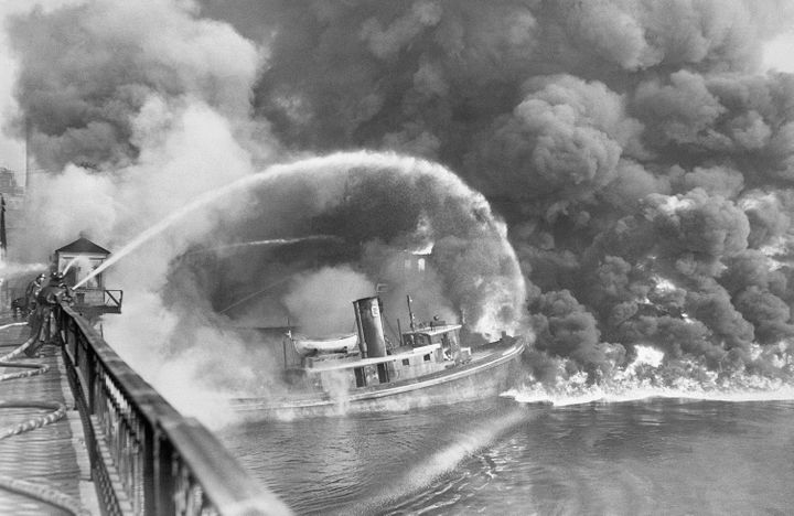 Ohio's polluted Cuyahoga River, a tributary of Lake Erie, is seen burning in 1952. The river was so clogged with waste t