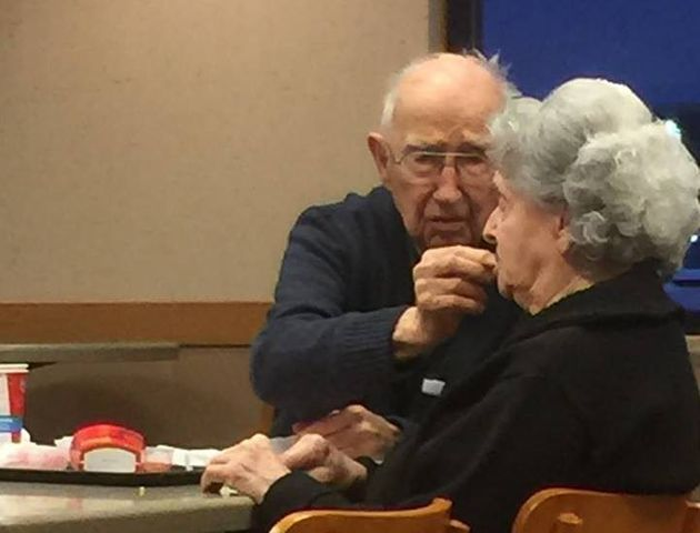 Bittersweet Photo Shows Tender Moment Husband Feeds Wife With Alzheimer's On Date