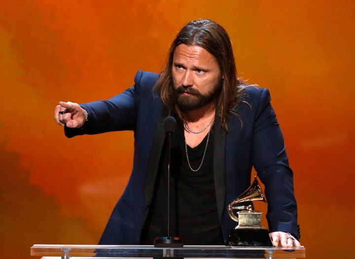 Max Martin, pop songwriter extraordinaire, points at something at the 2015 Grammy Awards.