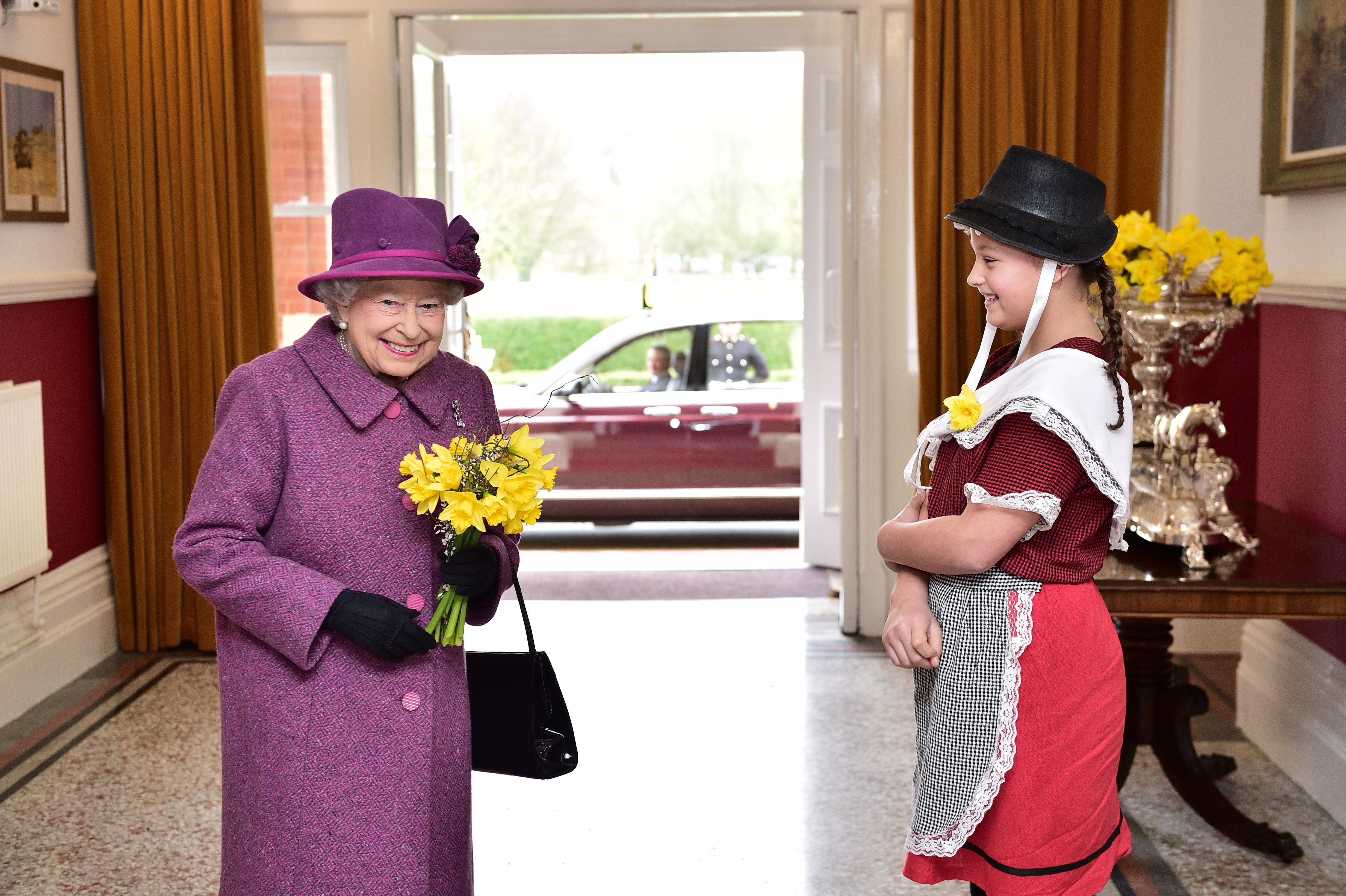 We wonder what signal the Queen is giving here?