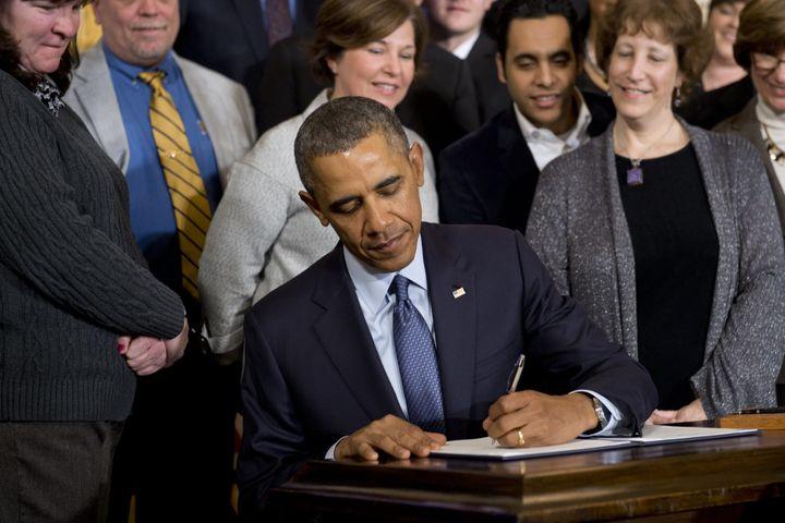 President Barack Obama signs a presidential memorandum directing the labor secretary to updateovertime regulations&nbsp