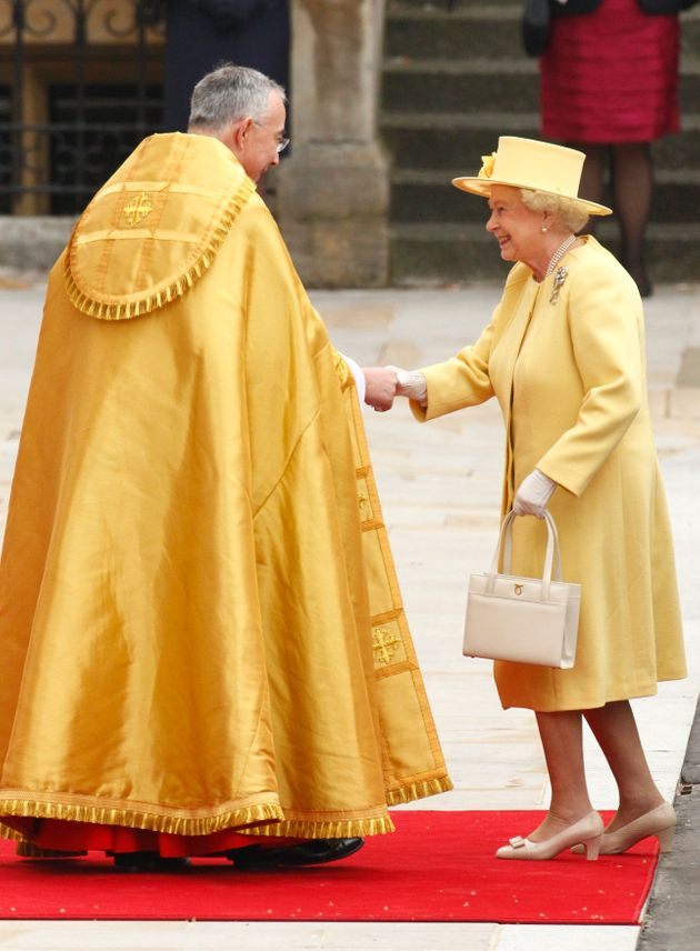 Queen Elizabeth is welcomed by the Right Reverend John Hall, Dean of Westminster as she arrives before...