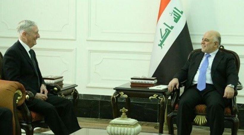 US Secretary of Defense James Mattis speaks with Iraqi Prime Minister Haider al-Abadi in Baghdad on Feb. 20. Photo: Iraqi PM