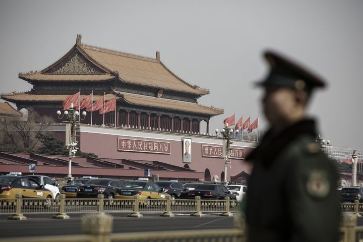 Members of the Chinese People's Armed Police stand guard at Tiananmen Square, as 3,000 lawmakers from across China desce