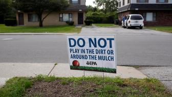 EAST CHICAGO, IN - SEPTEMBER 4: A sign displayed in a front yard request that residents keep fro playing in the dirt or mulch at the West Calumet Housing Complex on September 4, 2016 in East Chicago, Indiana. The soil at the complex has been found to contain high levels of lead and arsenic putting all residents in danger if exposed to the elements. Over 1,000 residents are being asked by the East Chicago Housing Authority to relocate, after plans were decided to demolish the housing complex. (Photo by Joshua Lott/Getty Images)