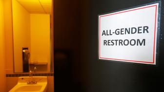 "A sign marks an ""All-Gender Restroom"" at the Radcliffe Institute for Advanced Study at Harvard University in Cambridge, Massachusetts, U.S. May 13, 2016.  REUTERS/Brian Snyder"