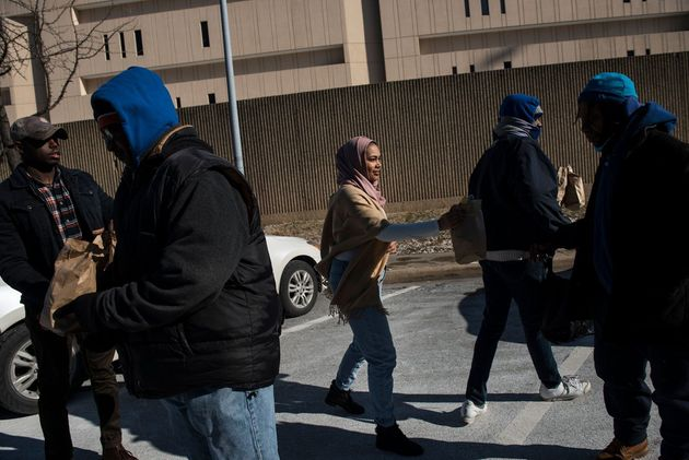 Lyric Harris distributing meals to the homeless in Baltimore with her husband, a Chad-born American citizen...