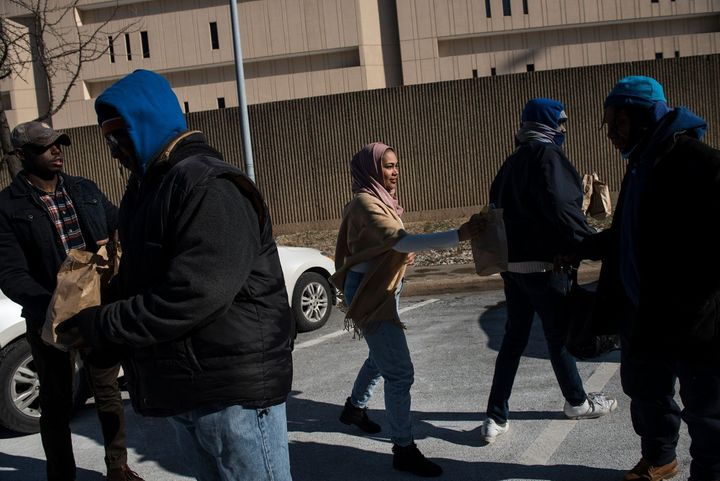 Lyric Harris distributing meals to the homeless in Baltimore with her husband, a Chad-born American citizen who is now an ROT