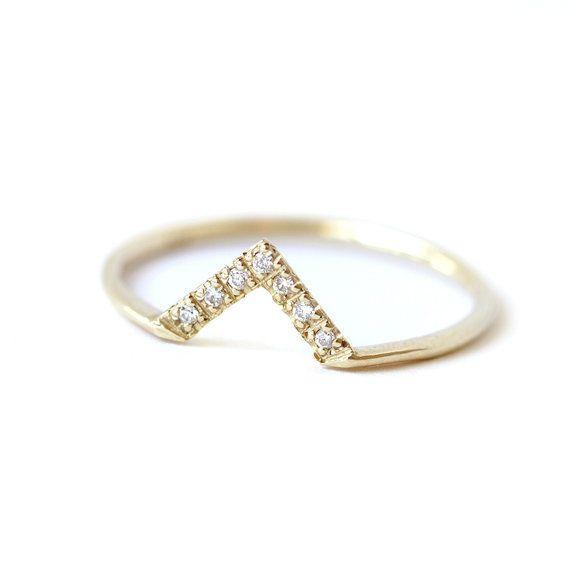 "<i>Buy it <a href=""https://www.etsy.com/listing/207815662/dainty-wedding-band-diamond-v-ring?ref=shop_home_active_10"" target="