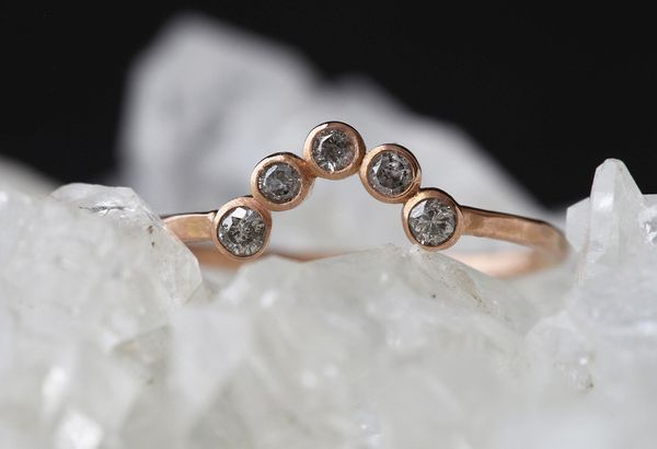 """<i>Buy it <a href=""""http://www.alexisrussell.com/collections/wedding-bands/products/diamond-bezel-arc-ring"""" target=""""_blank"""">he"""