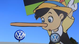 A Pinocchio placard stands during a protest by members of the environmental action group Greenpeace outside the Volkswagen AG headquarters in Wolfsburg, Germany, on Friday, Sept. 25, 2015. Volkswagen is set to appoint Porsche brand chief Matthias Mueller as its new CEO and announce the departure of top executives in a sweeping overhaul to begin repairing the carmaker's image tarnished by rigged emissions tests. Photographer: Krisztian Bocsi/Bloomberg via Getty Images