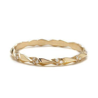 """<i>Buy it <a href=""""http://www.annasheffield.com/collections/bands/products/yellow-gold-tiny-sheaves-pave-band"""" target=""""_blank"""