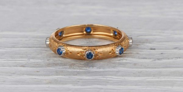 """<i>Buy it <a href=""""https://erstwhilejewelry.com/collections/vintage-wedding-bands/products/vintage-buccellati-gold-and-sapphi"""