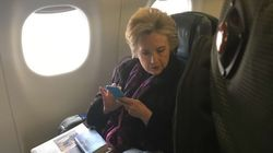 Hillary Clinton Photographed On Plane Reading About Mike Pence's