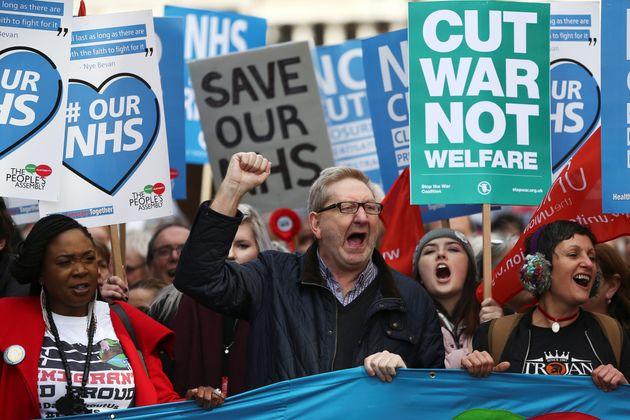 Unite union leader Len McCluskey (C) takes part in a