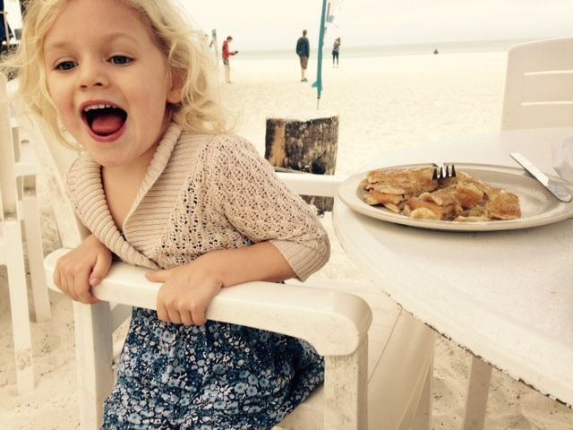 My granddaughter happily enjoying her beach front breakfast.