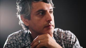 LOS ANGELES, CA - AUGUST 8, 2013 - Dr. Reza Aslan, author of the book 'Zelot' poses at his home on August 8, 2013, in Los Angeles, California. Dr. Aslan's doctorate in the sociology of religions encompasses expertise in the history of religion. Aslan's bachelor's degree is in religious studies, with an emphasis on scripture and traditions. His minor was in biblical Greek. He has a master of theological studies degree from Harvard University, in world religions, and a Ph.D. from the University of California, Santa Barbara, in the sociology of religions. Reza also has a master of fine arts degree from the University of Iowa. Dr. Aslan is currently associate professor of creative writing at the University of California, Riverside, and a cooperative faculty member in the department of religion, and he teaches in both disciplines. He was previously Wallerstein Distinguished Visiting Professor of religion at Drew University, where he taught from 2012 to 2013, and assistant visiting professor of religion at the University of Iowa, where he taught from 2000 to 2003. He has written three books on religion. (Photo by Bret Hartman/For The Washington Post via Getty Images)