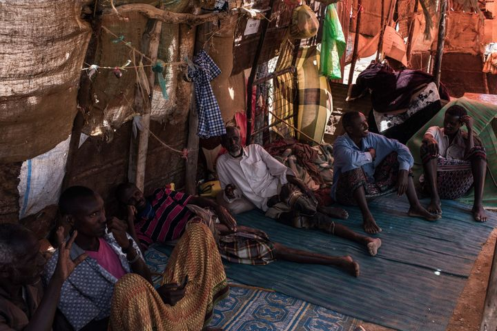 Men talk inside a tent at a camp for internally displaced people in Karin Sarmayo, Somalia.