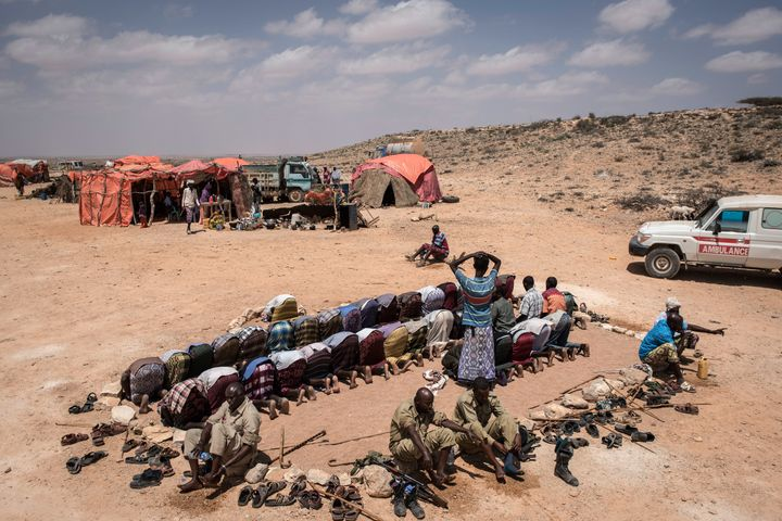 Men pray at the camp for internally displaced people in Karin Sarmayo.