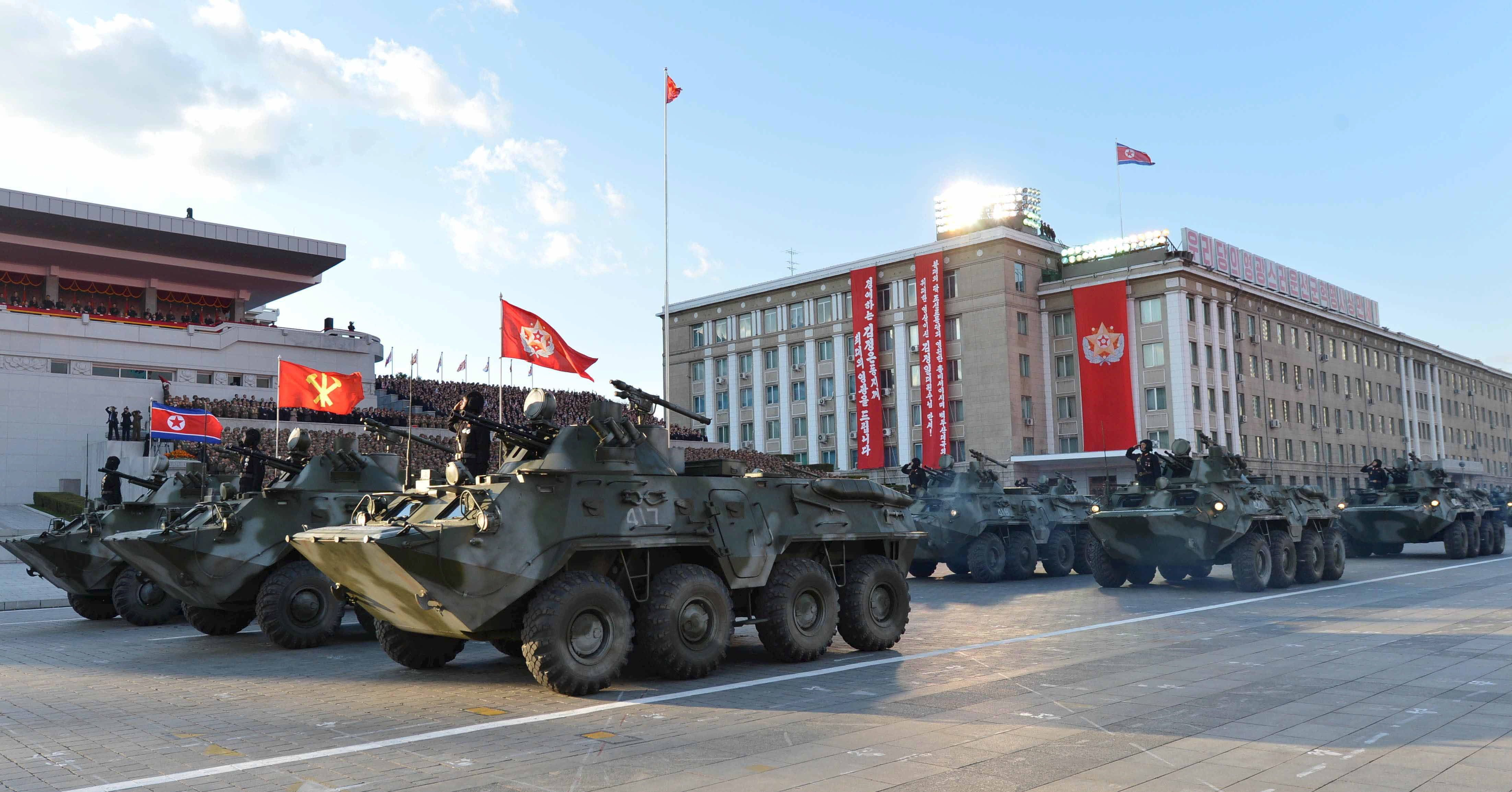 North Korean military participate in the celebration of the 70th anniversary of the founding of the ruling Workers' Party of Korea, in this undated photo released by North Korea's Korean Central News Agency (KCNA) in Pyongyang on October 12, 2015. Isolated North Korea marked the 70th anniversary of its ruling Workers' Party on Saturday with a massive military parade overseen by leader Kim Jong Un, who said his country was ready to fight any war waged by the United States. REUTERS/KCNA  ATTENTION EDITORS - THIS PICTURE WAS PROVIDED BY A THIRD PARTY. REUTERS IS UNABLE TO INDEPENDENTLY VERIFY THE AUTHENTICITY, CONTENT, LOCATION OR DATE OF THIS IMAGE. FOR EDITORIAL USE ONLY. NOT FOR SALE FOR MARKETING OR ADVERTISING CAMPAIGNS. NO THIRD PARTY SALES. THIS PICTURE IS DISTRIBUTED EXACTLY AS RECEIVED BY REUTERS, AS A SERVICE TO CLIENTS. SOUTH KOREA OUT. NO COMMERCIAL OR EDITORIAL SALES IN SOUTH KOREA.