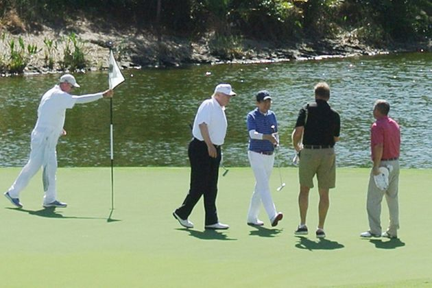 Trump (2nd L) and Japan's Prime Minister Shinzo Abe (C) playing golf in Florida on February