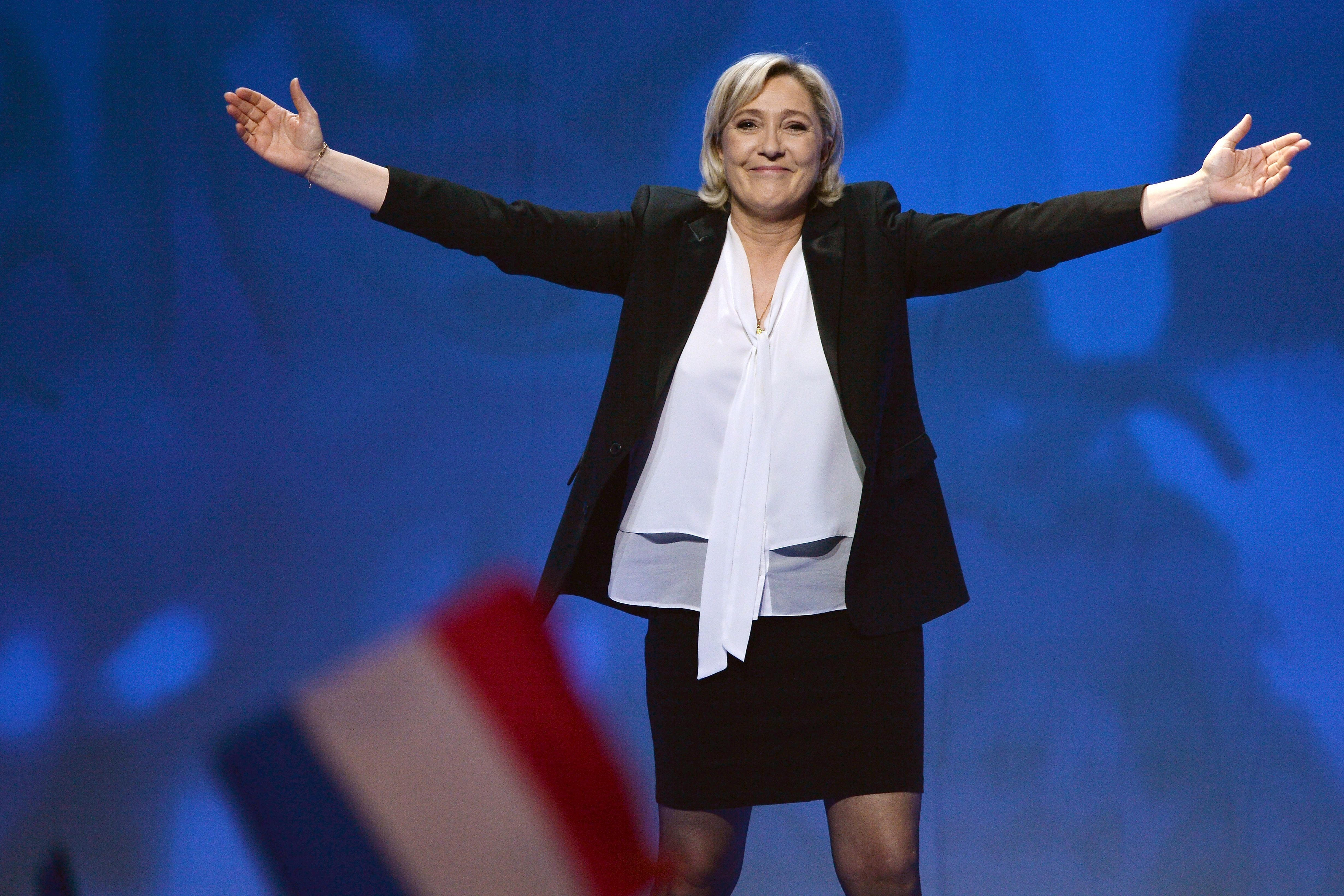 TOPSHOT - French far-right Front National (FN) party candidate for the presidential election Marine Le Pen waves as she arrives to speak on stage during a campaign rally at the Zenith de Nantes venue in Saint-Herblain on February 26, 2017.  / AFP / JEAN-FRANCOIS MONIER        (Photo credit should read JEAN-FRANCOIS MONIER/AFP/Getty Images)