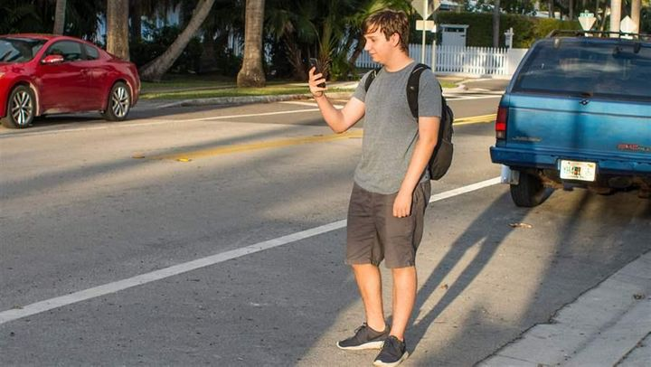 Henry Stock, 16, near his home in Hollywood, Florida. Like many teenagers, he doesn't feel the need to get a driver's license