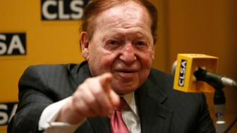 """Las Vegas Sands Corp Chairman and Chief Executive Officer Sheldon Adelson points a reporter during a news conference in Tokyo February 24, 2014. Adelson said on Monday his company was willing to spend """"whatever it takes"""" to set up a casino project in Japan, one of the largest untapped gaming markets in the world. REUTERS/Yuya Shino (JAPAN - Tags: ENTERTAINMENT BUSINESS)"""
