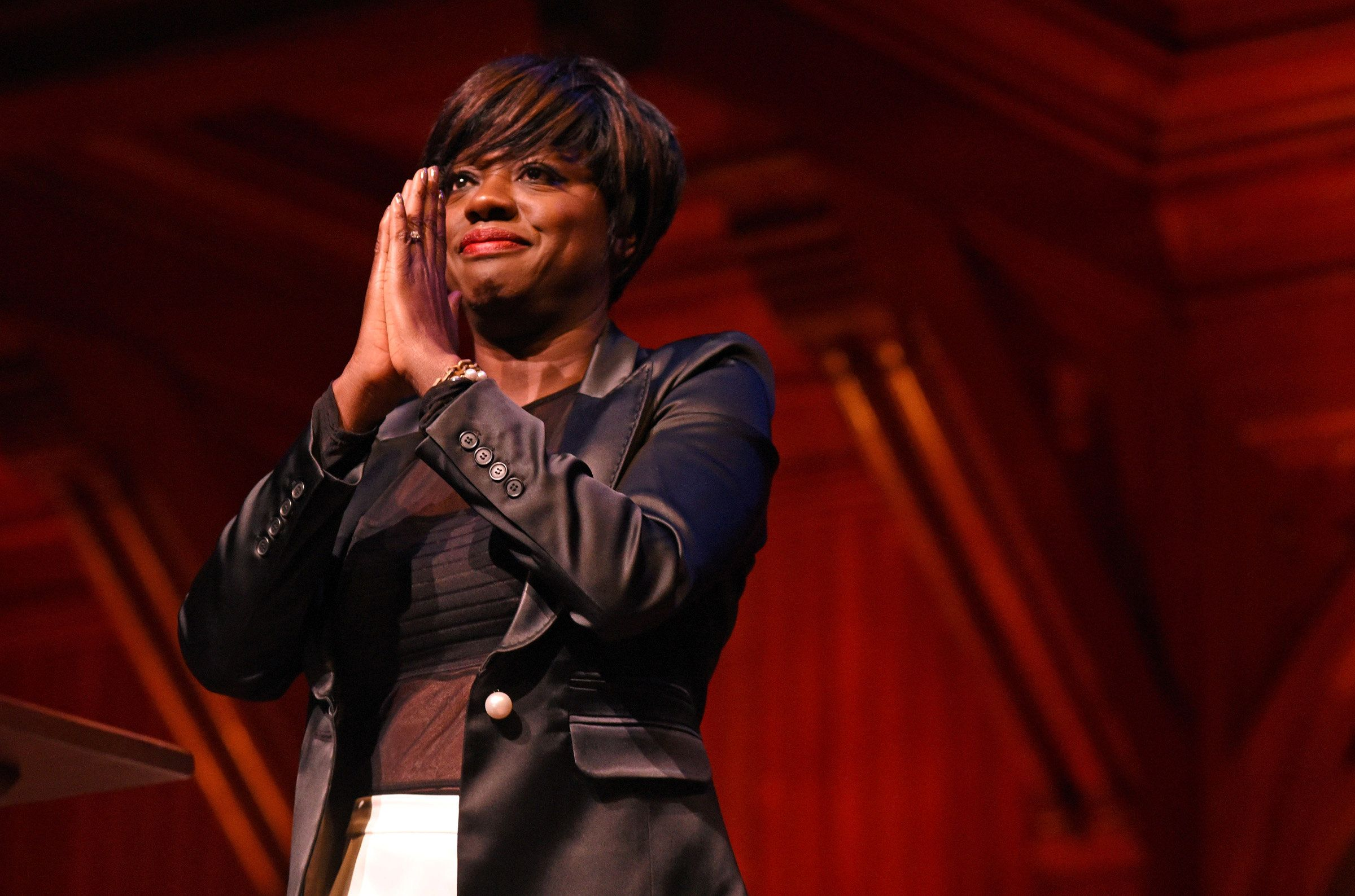 Actress Viola Davis gestures to the crowd after receiving the Harvard Foundation's arts medal during the 32nd annual Cultural Rhythms Festival in Sanders Theatre at Harvard University in Cambridge, Massachusetts, U.S., March 4, 2017.   REUTERS/Faith Ninivaggi