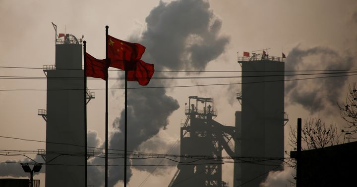 Chinese national flags are flying near a steel factory in Wu'an, Hebei province, China, February 23, 2017.