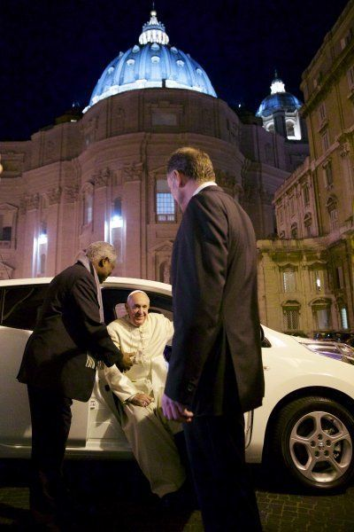 Pope Francis and his new electric car at the Vatican.