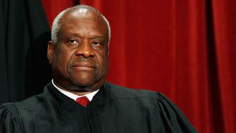 WASHINGTON - SEPTEMBER 29:  Associate Justice Clarence Thomas poses with other justices during a group photograph at the Supreme Court building on September 29, 2009 in Washington, DC. The high court made a group photograph with its newest member Associate Justice Sonia Sotomayor.  (Photo by Mark Wilson/Getty Images)