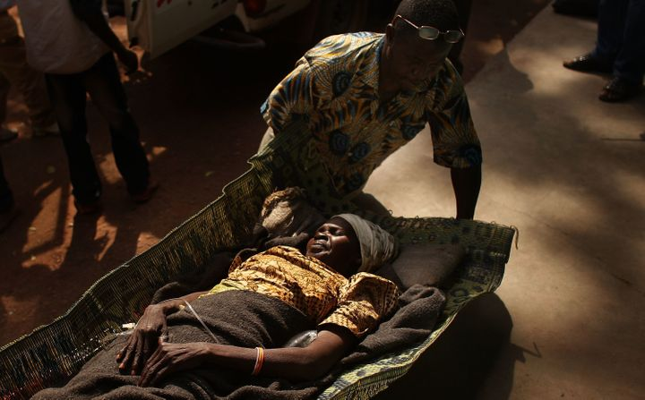 A woman is brought to a health clinic with an advanced case of rabies, Dec. 15, 2007, in Kabo in the northern Central African