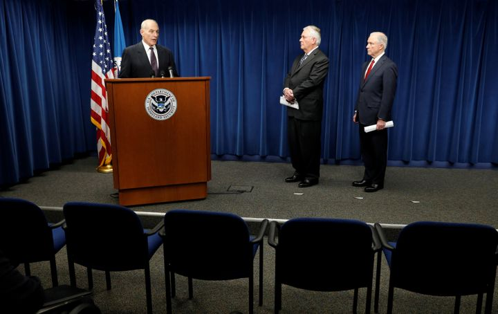 Homeland Security Secretary John Kelly (L), Secretary of State Rex Tillerson (C) and Attorney General Jeff Sessions (R), deli