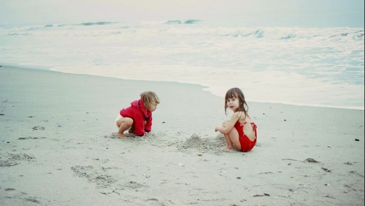 Playing at the beach with my older sister