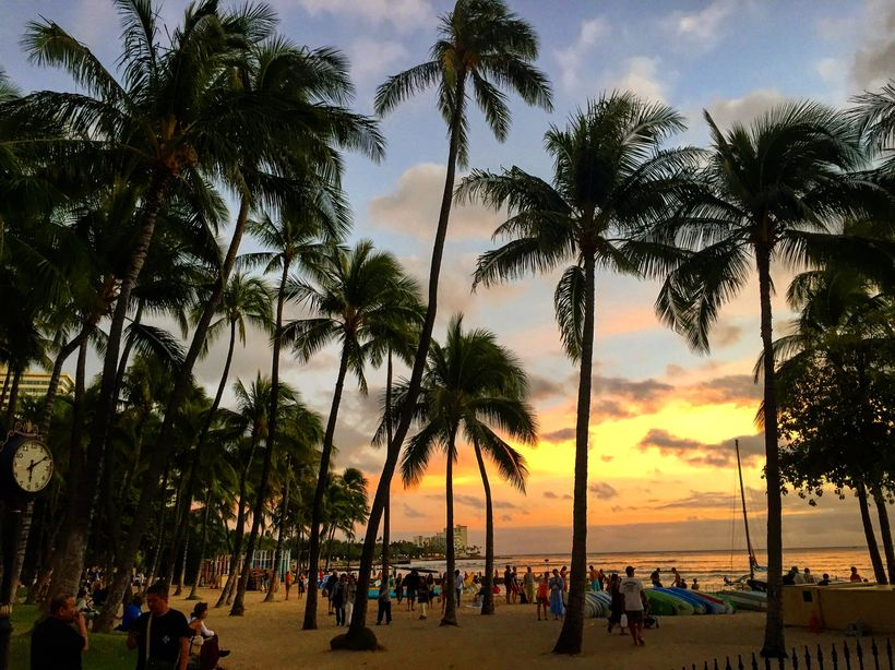 The sunsets at Waikiki are every bit as colorful as they would have been for Mark Twain.
