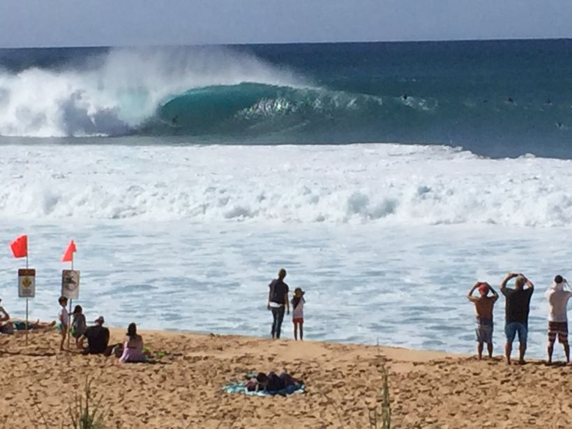 The waves break so close to shore at Banzai-Pipeline you can photograph a surfer in a curl with a cell phone.