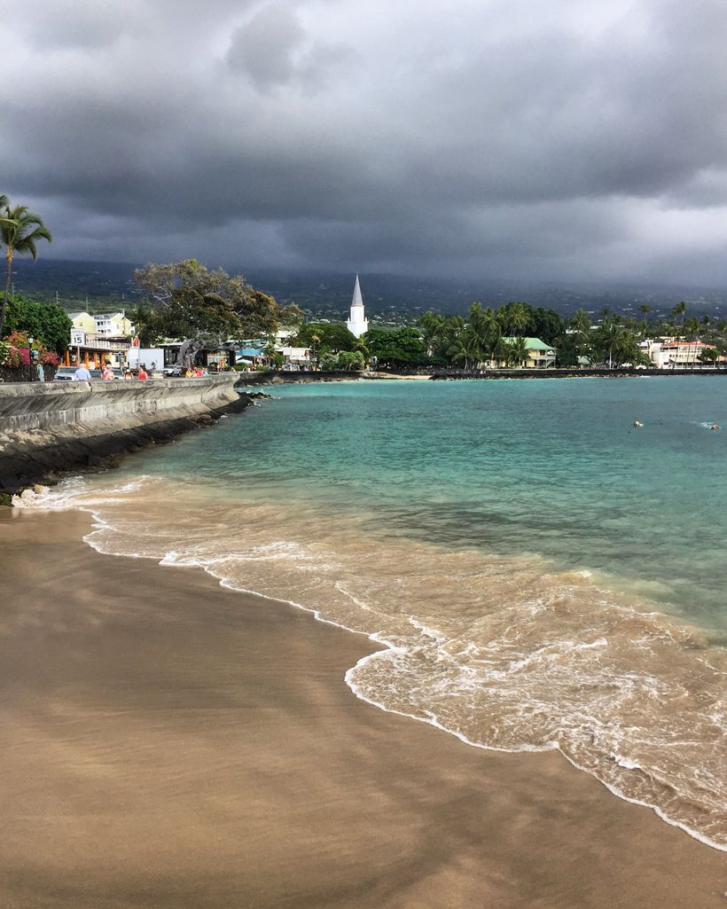 The town of Kailua occupies one side of the street, the bay the other.