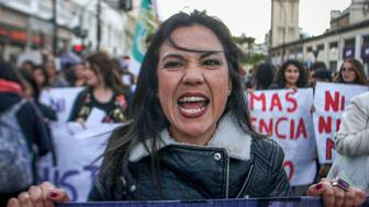 """CHILE, VALPARAISO - OCTOBER 19: Feminist activists protest on the streets during a national demonstration called """"Ni Una Menos (not one woman less)"""" to demand justice for all women victims of gender crimes  and  in repudiation to the murder of Florencia Aguirre, a nine  year old girl who was strangled, burned and buried by his father in the city of Coyhaique on October 19, 2016, Valparaiso, Chile. (Photo by Marcelo Benitez/Latincontent/Getty Images)."""