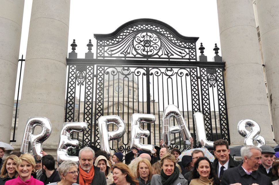 Protesters call for the repeal of Ireland's Eighth Amendment, one of the strictest anti-abortion laws in the world, at a Dubl