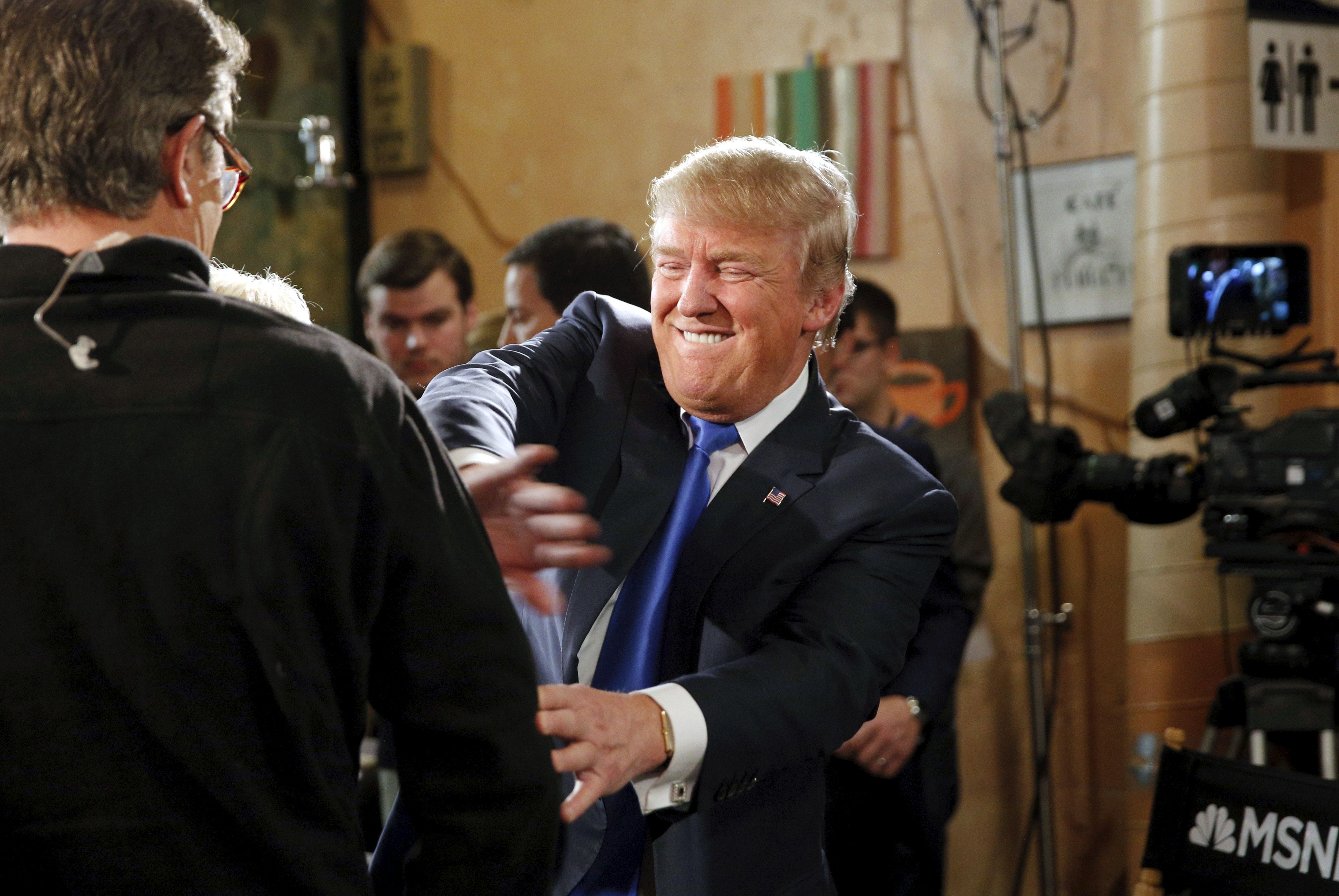 U.S. Republican presidential candidate Donald Trump jokes with host Joe Scarborough after an appearance on MSNBC's Morning Joe cable television show at Java Joe's CoffeeHouse in Des Moines, Iowa, January 15, 2016. REUTERS/Scott Morgan      TPX IMAGES OF THE DAY